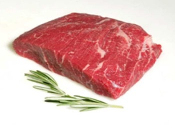 fresh flat iron beef steak with a sprig of rosemary